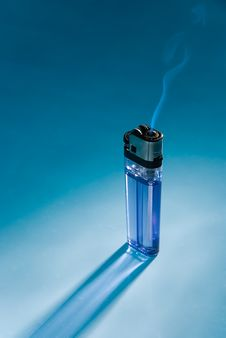 The Fuming Cigarette Lighter On Blue Stock Images