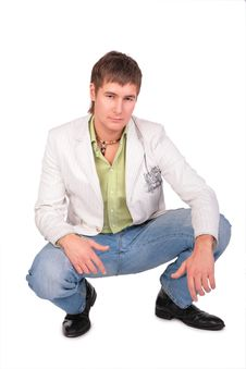 Free Serious Young Man Sits Royalty Free Stock Photography - 5042677