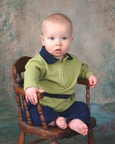Baby On Wooden Chair Royalty Free Stock Photography