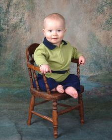 Smiling Baby On Wooden Chair Royalty Free Stock Image