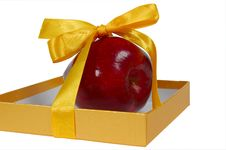 Free Red Apple In Box With Yellow Tape Like Gift Stock Photo - 5043690