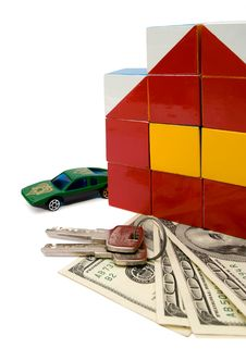 Free Toy House And A Car Over A Bunch Of Dollars, Isola Stock Photography - 5047212