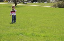 Free Child On The Green Lawn Royalty Free Stock Photos - 5049058