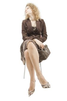 Free Women With A Bag Sits On A Chair Stock Image - 5050221