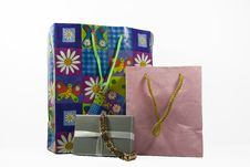 Free Gift Bags With Gold Bracelet Royalty Free Stock Photography - 5050657