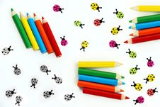 Colored Pencils And Ladybirds Royalty Free Stock Photography