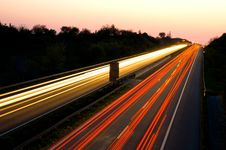 Free Traffic On A Highway At Night Royalty Free Stock Photo - 5053915