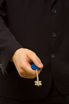 Free Businessman Is Giving You A Key Stock Photo - 5054690