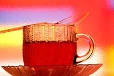 Glass Teacup, Saucer And Spoon Royalty Free Stock Images