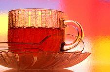Glass Teacup, Saucer And Spoon Stock Photos