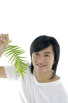 Free Man On Holding A Small Plant Stock Photography - 5056582