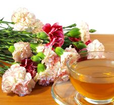 Cup Of Tea And Bouquet Of Carnations Royalty Free Stock Photo