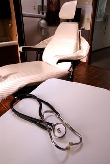 Stethoscope On White Table Before Chair Stock Image