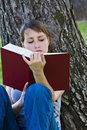 Free Young Enjoying A Book Royalty Free Stock Photo - 5064325