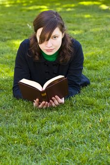 Free Reading On The Grass Stock Image - 5063421