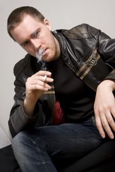 Free Man Smoking A Cigarette Stock Images - 5066294