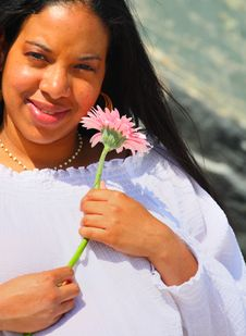 Free Woman Holding A Pink Daisy Stock Image - 5067691