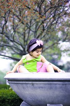 Free Girl In A Flower Pot Royalty Free Stock Photo - 5067725