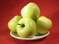 Several Green Apples On Red Royalty Free Stock Photo