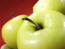 Three Green Apples On Red 2 Royalty Free Stock Photos