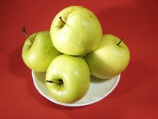 Free Several Green Apples On Red Stock Photos - 5068313