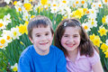 Free Friends Sitting In Flowers Royalty Free Stock Photography - 5071747