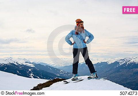 Free Skier At The Peak Of The Mountain Stock Photos - 5074273