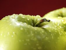Free Green Apple On Red With Water Drops Stock Photo - 5071080