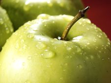 Free Green Apple On Red With Water Drops Stock Image - 5071091