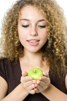 Free Holding An Apple Stock Image - 5071871