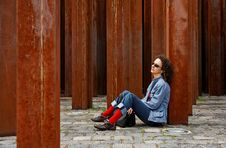Woman Waits Between Rusty Colu Stock Photos