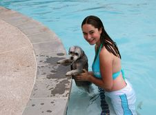 Free Young Girl And Dog Swimming Stock Photography - 5073892
