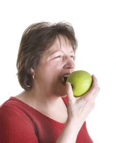 Free Woman In Red Eating Green Apple Stock Photo - 5074390