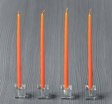 Free Orange Candles On A Grey Textured Background Royalty Free Stock Images - 50724439