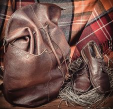 Free Leather Products Against The Background Of Wool Tartan Stock Image - 50724481