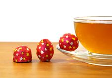 Three Candys And Tea Royalty Free Stock Photos