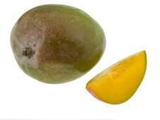Whole Mango And Slice Royalty Free Stock Photos