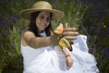 Free Young Girl In White Dress Holding Orange Butterfly Royalty Free Stock Photography - 5085637