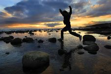 Free Silhouette Jumping At Sunset Stock Image - 5086481