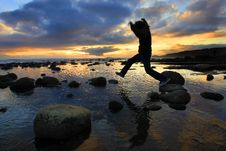 Free Silhouette Jumping At Sunset Stock Photos - 5086523