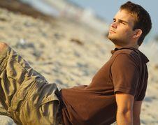 Free Man Sitting On Sand Royalty Free Stock Photo - 5086995