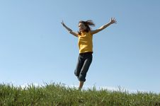 Free Girl Jumps At Top Of A Hill Royalty Free Stock Photo - 5087535