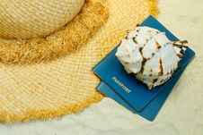 Free Straw Hat, Seashell And Passports On The Sand Stock Images - 5088274