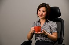 Free Asian Lady In Business Attire, Holding A Cup Royalty Free Stock Images - 5088709
