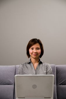 Free Asian Lady In Business Attire, Using A Computer Stock Photos - 5088983