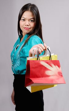 Young Asian Woman With Shopping Bags Stock Image