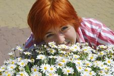 Free Beautiful Woman Red Hair Hugs Flowers Chamomile Royalty Free Stock Photos - 5091258