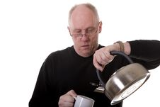 Free Man In Black Pouring Tea Into Mug Royalty Free Stock Image - 5091906