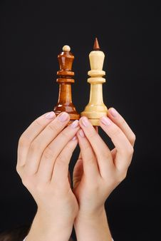 Two Hands With Chesspieces Stock Photography