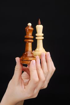 Two Hands With Chesspieces King And Queen Stock Images